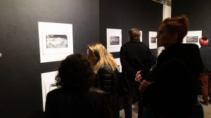 a number of people looking at art work