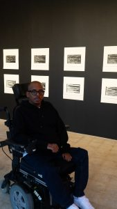 artist with his exhibition