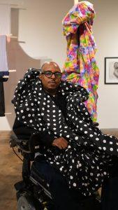artist chris samuel in his wheelchair and polka dot material