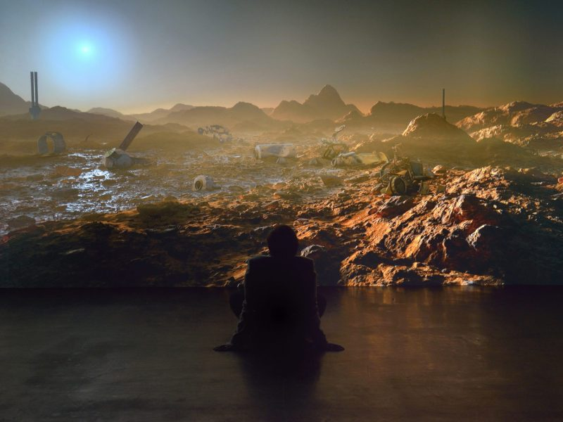a silhouette sat in front of a martian landscape