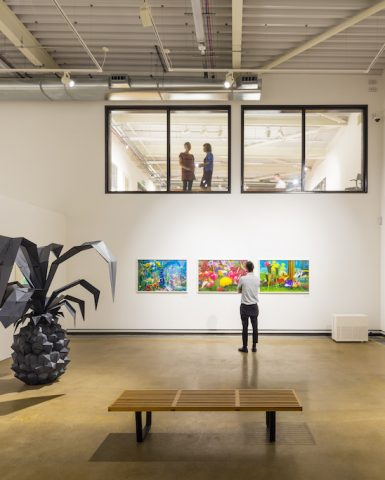 a gallery with art adorning the walls