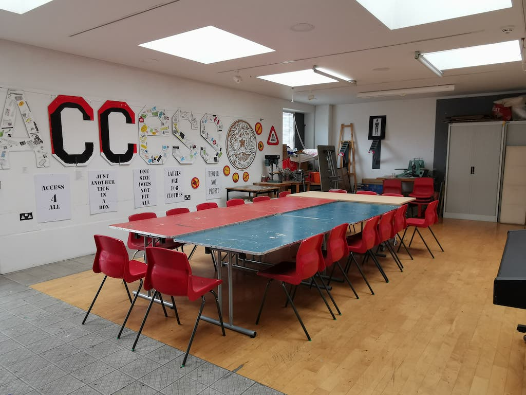 a large table in a creative workshop