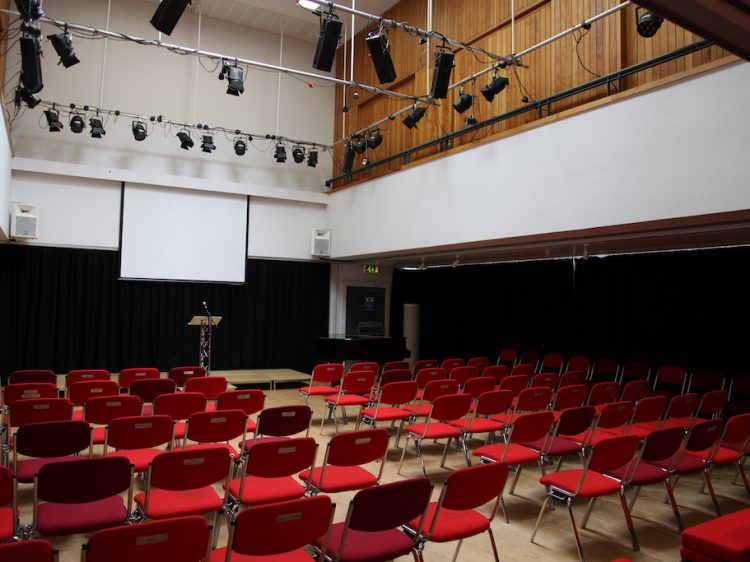 a theatre space with chairs set out