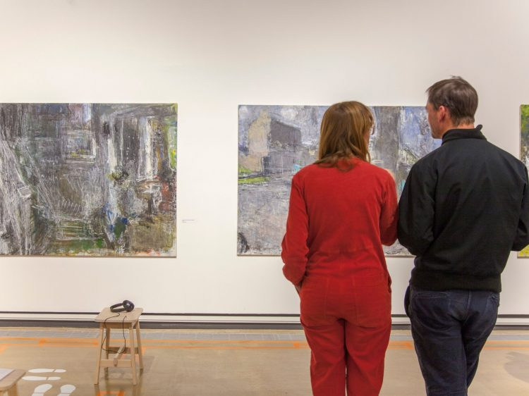 a couple looking at art