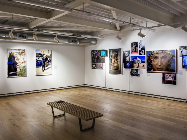 a gallery with photos adorning the walls