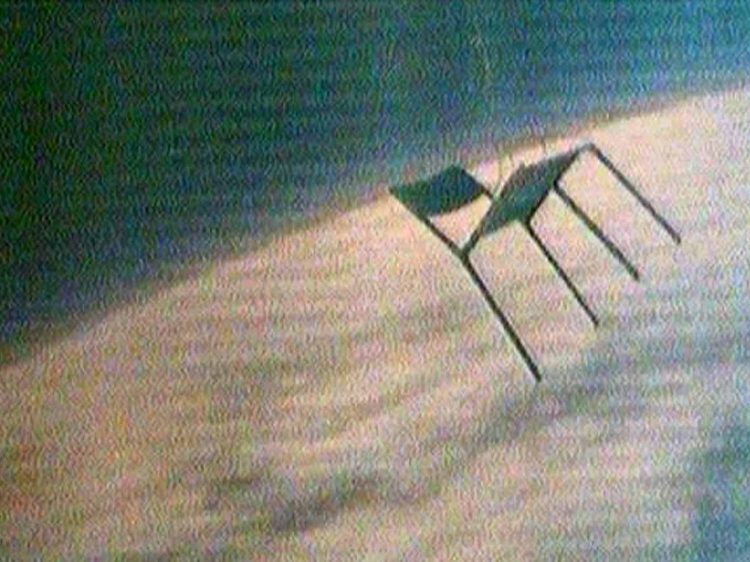 an image of a chair floating above the earth