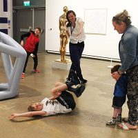 a child on the floor dancing in the gallery