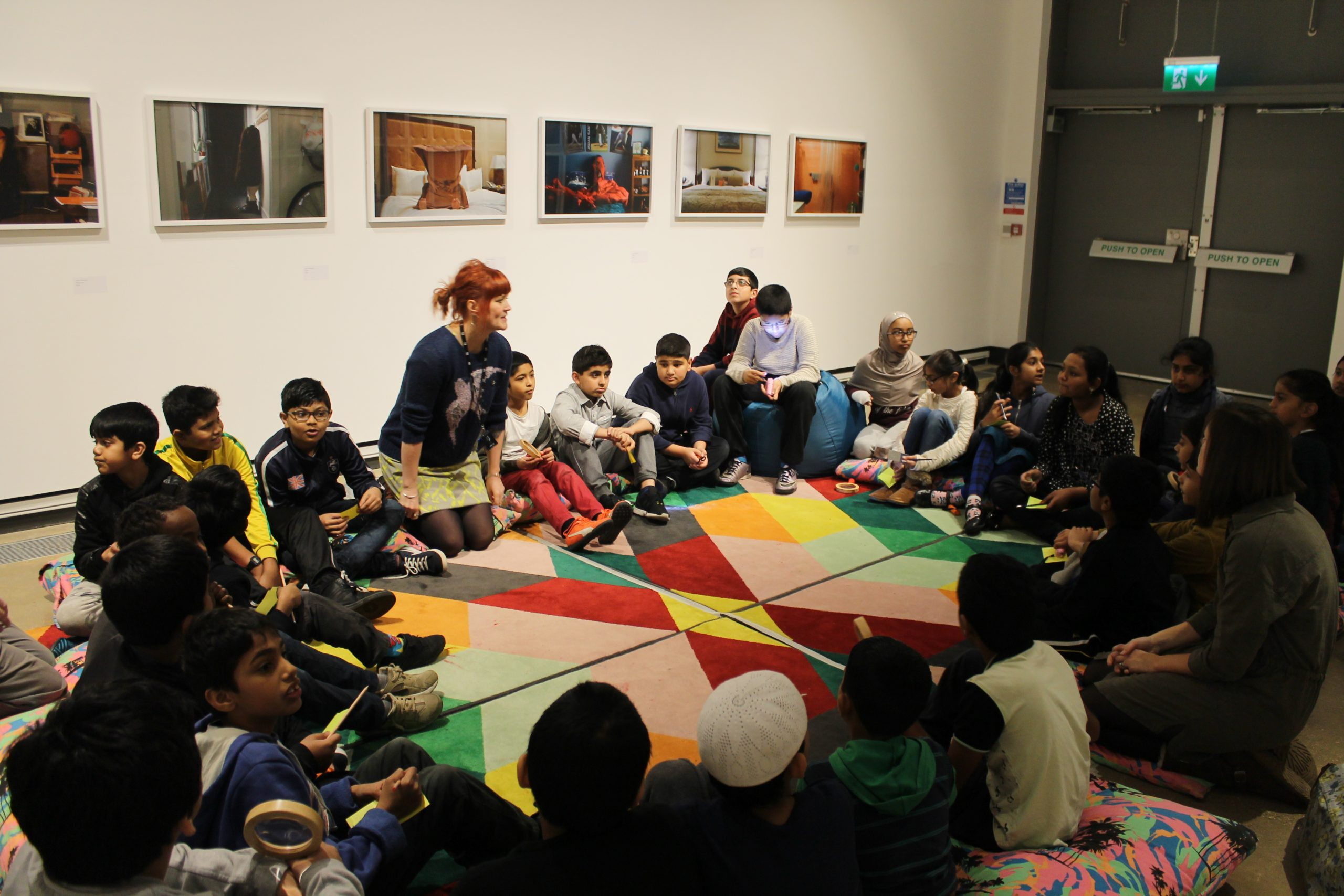 a school group in a circle on the floor
