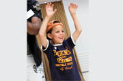 a child with his arms raised cheering