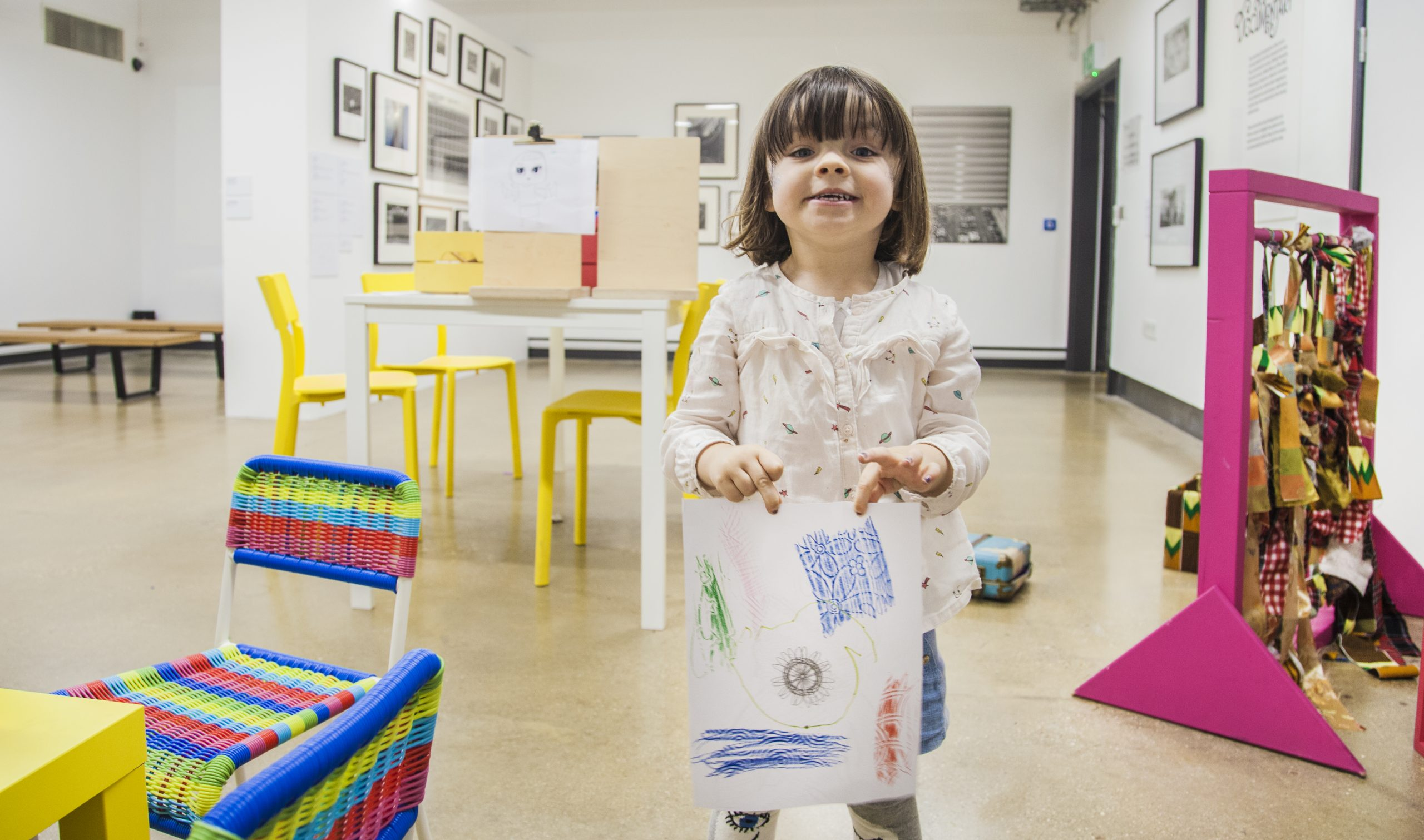 a young girl playing in the gallery
