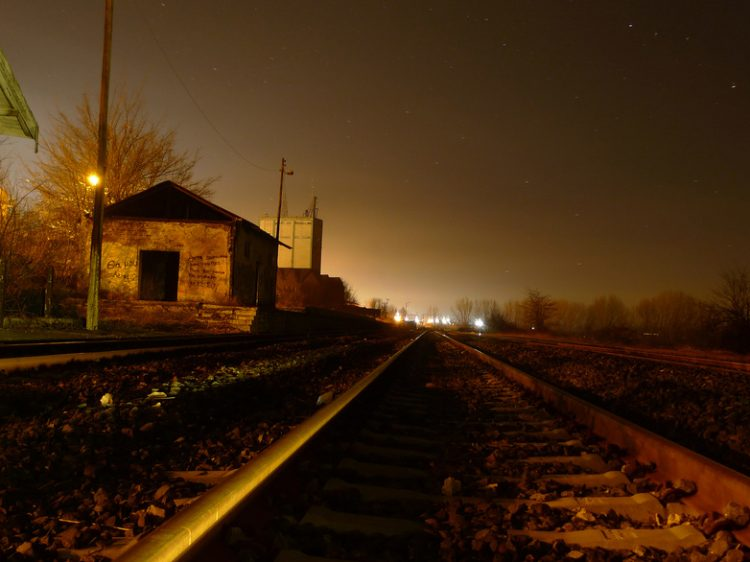 An abandoned, simple trainstation at dusk