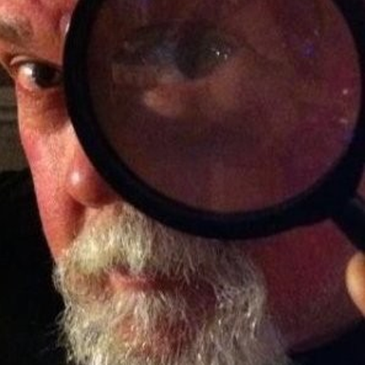Steve looking through a magnifying glass