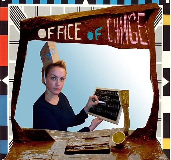 text of office of change cut into cardboard