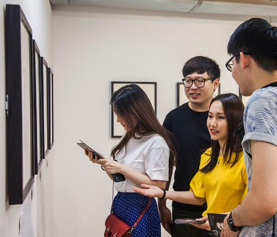 students looking at the gallery