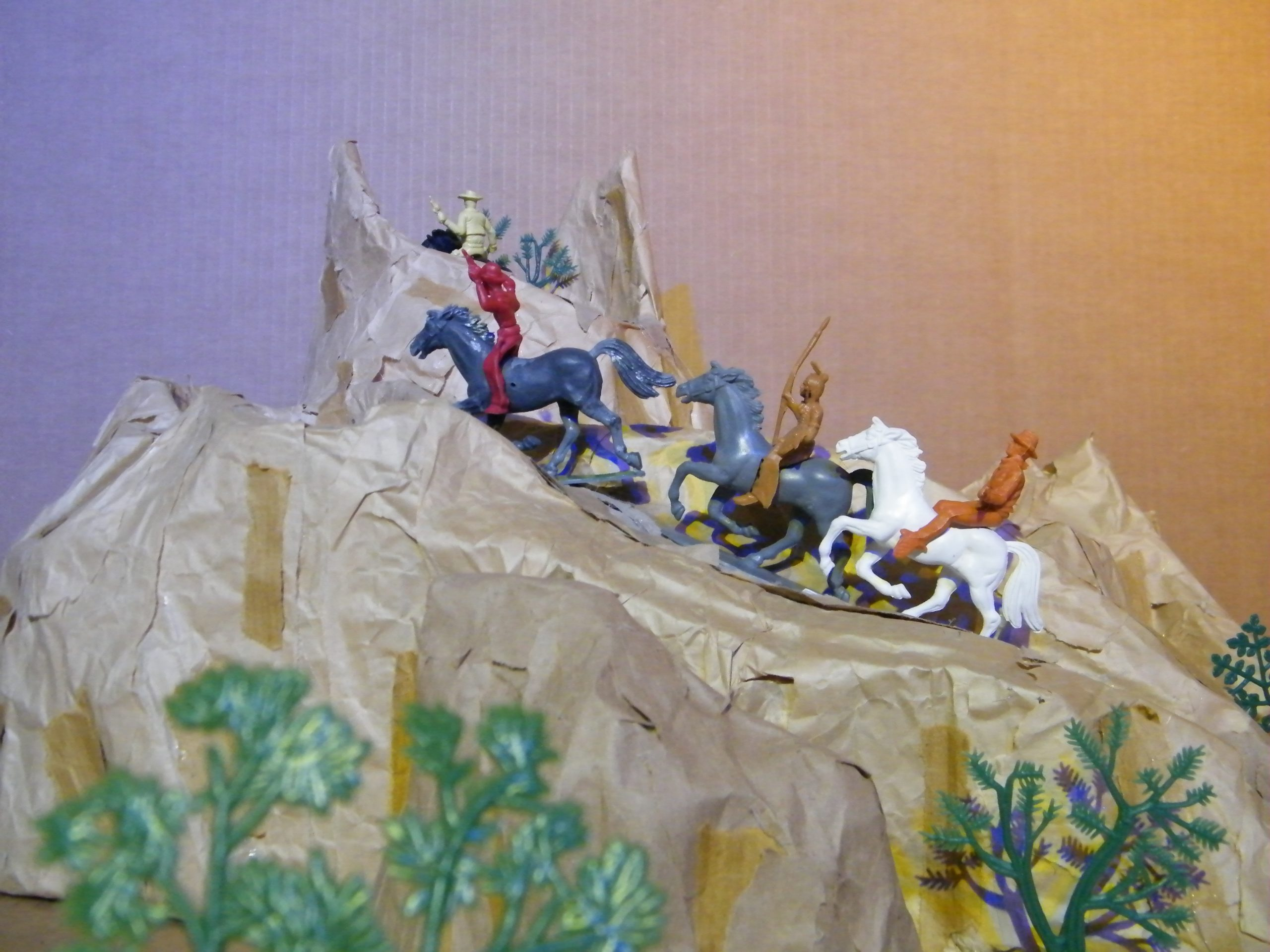 Plastic cowboys and native Americans fighting