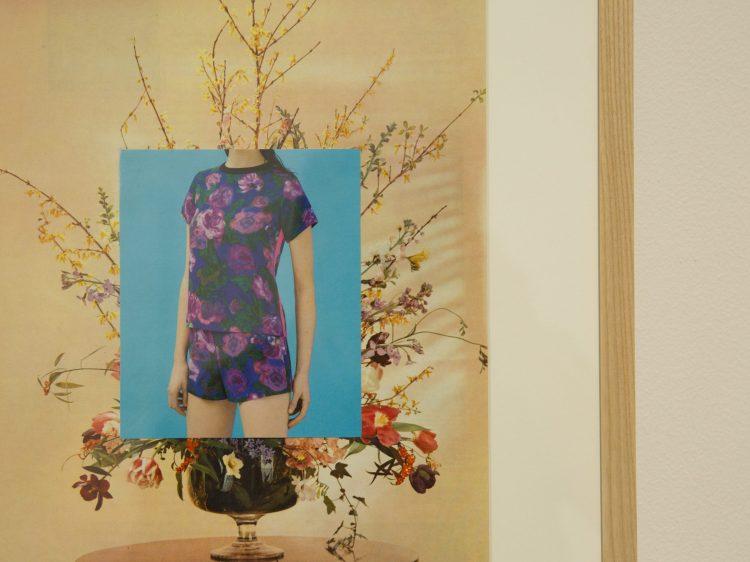 A photo of a woman's torso, wearing a floral jumpsuit