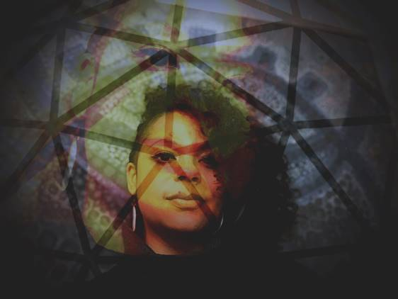 A woman staring to camera, with triangles overlaying image