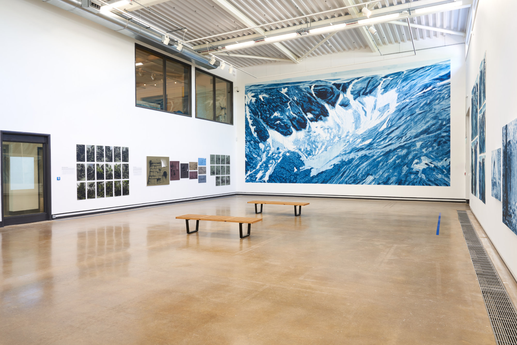 a large gallery with pictures and paintings on the walls