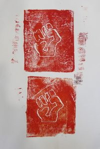 A block painting of two closed fists in red and white