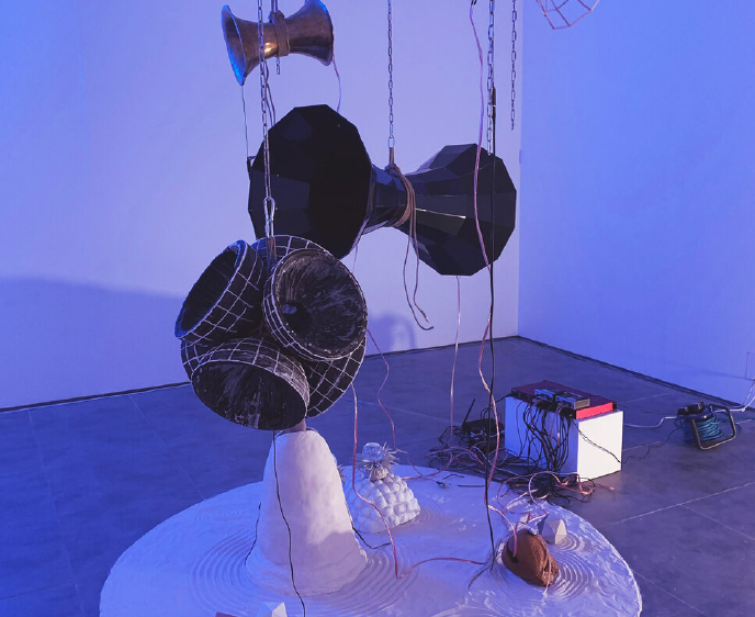Exhibition of various sculptures hanging from the ceiling and also on the floor