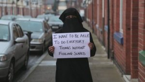 Person holding up a sign which reads: I want to do be able to do everyday things without feeling scared
